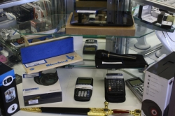 Many different items including Microphones; calculators; Headphones; etc.
