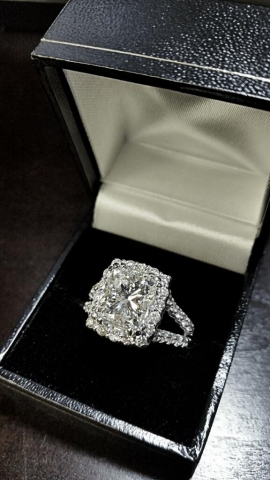 4.5 carat total weight diamond ring set in 14 karat white gold