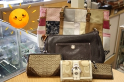 Selection of Coach purses and wallets